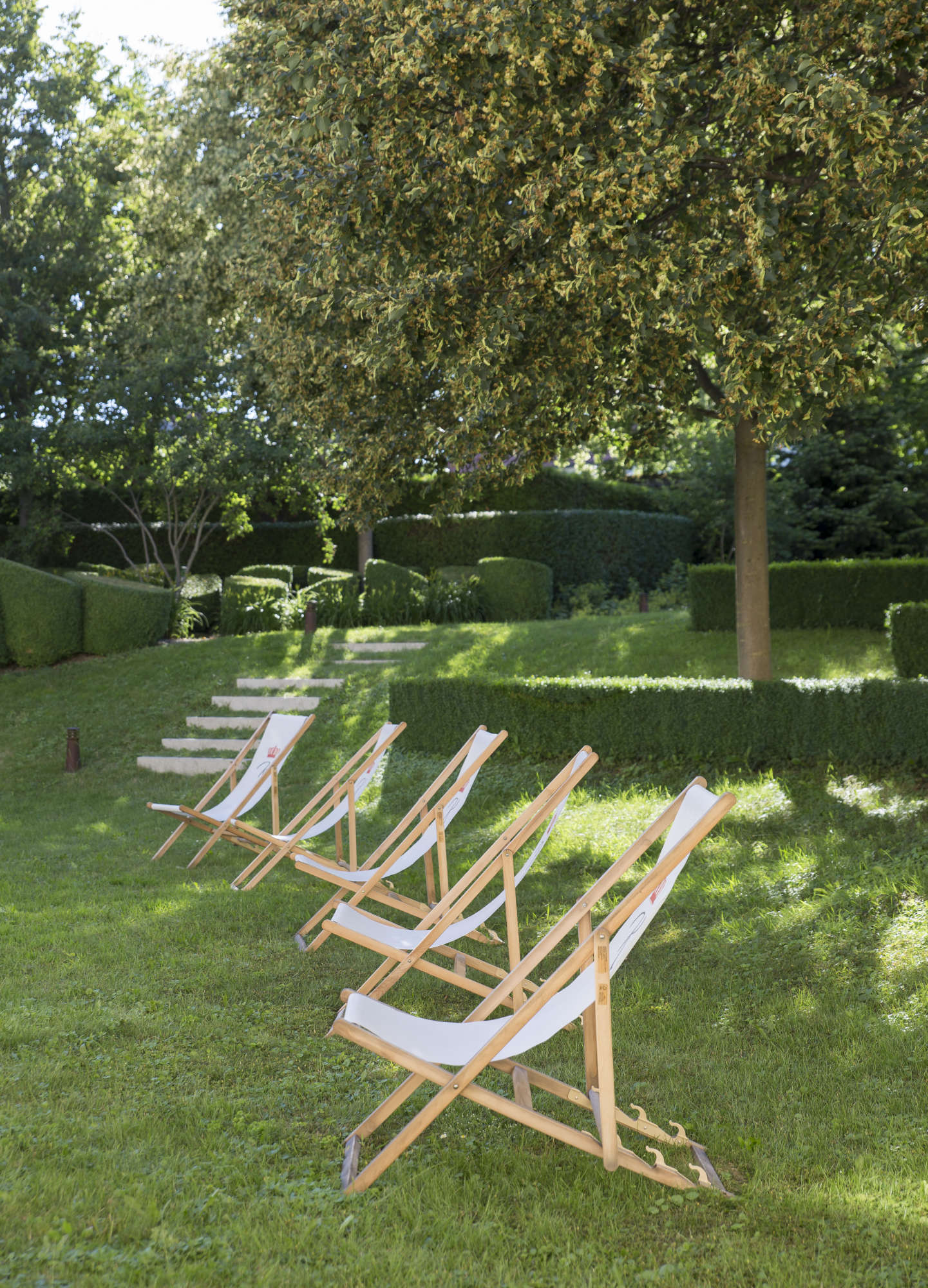 Folding deckchairs for meetings in the hotel garden