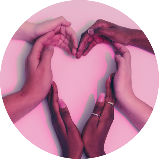 A diverse group of hands forming a heart