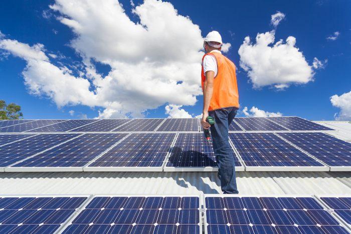 Technician installing solar panels.