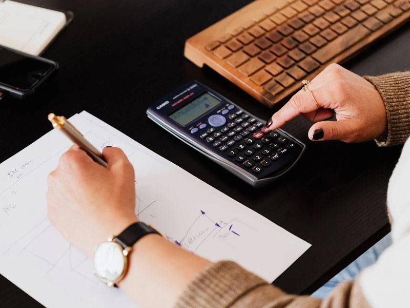 Woman using a calculator.
