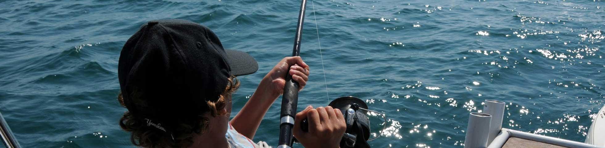 Man fishing on high sea.
