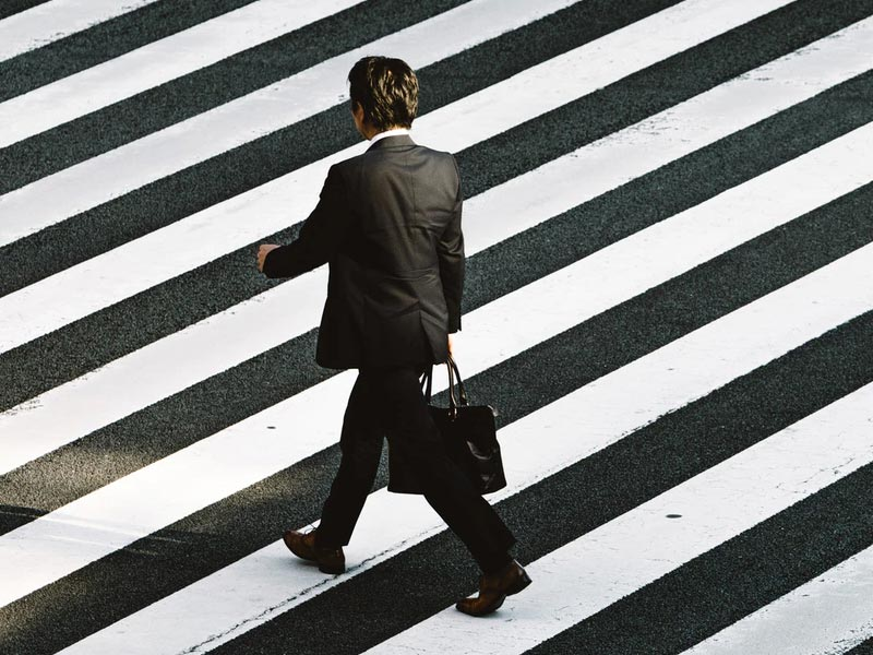 A man crossing the road.