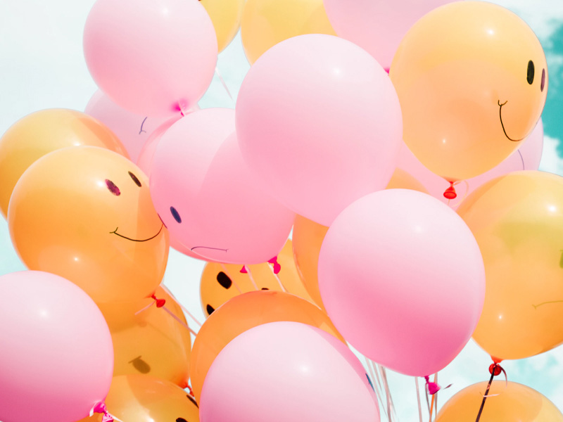 Balloons with smiley faces.