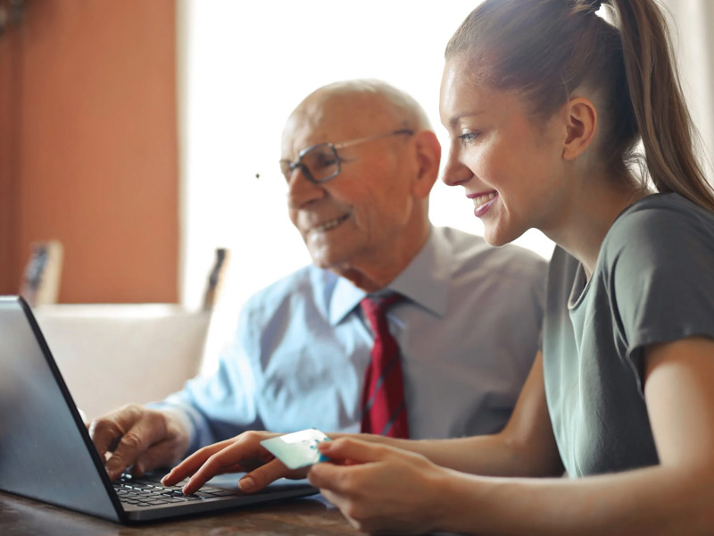 Man and Woman with computer and credit card.