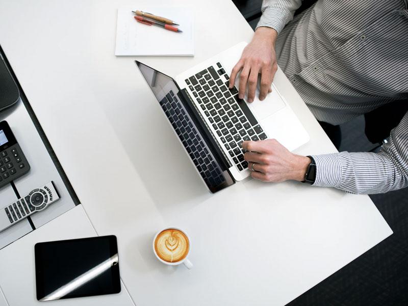 Business man sitting on a desk.
