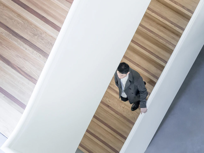 Man walking down the stairs.
