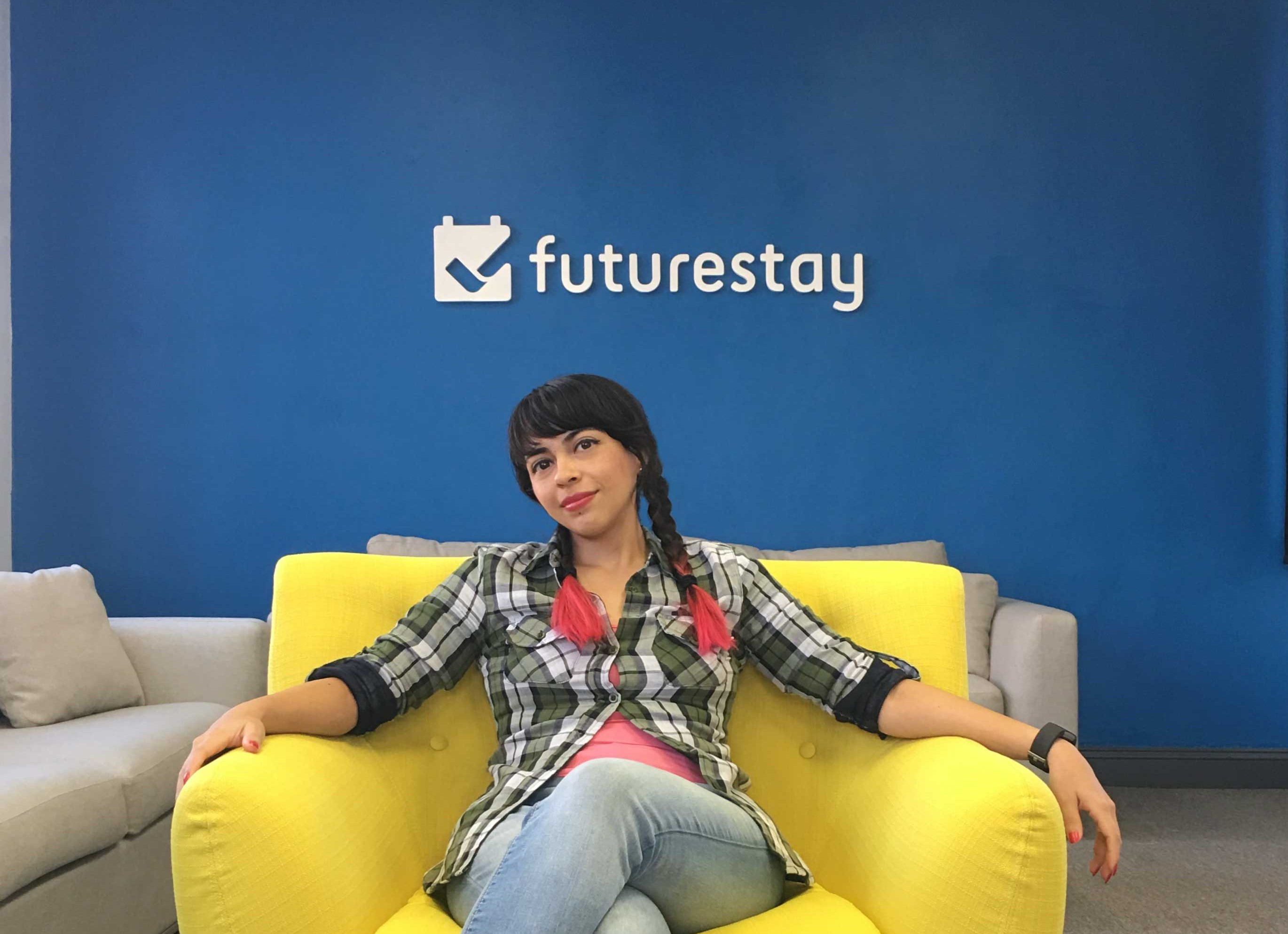Abbi in front of the Futurestay logo
