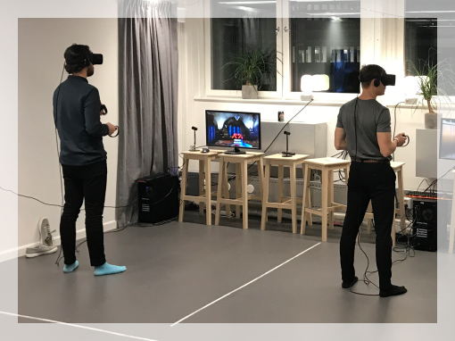 Image of two people playing VR
