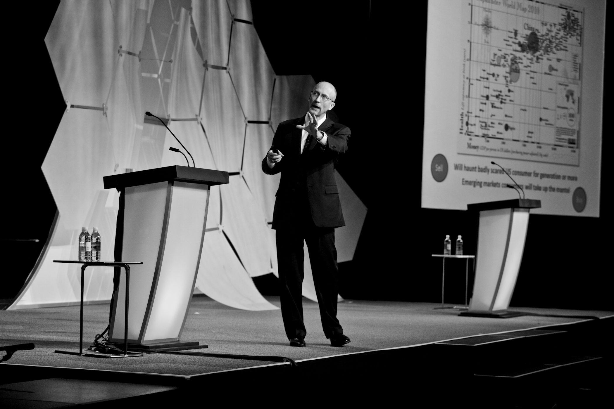 Keith Fitz-Gerald Speaking on a stage at a seminar