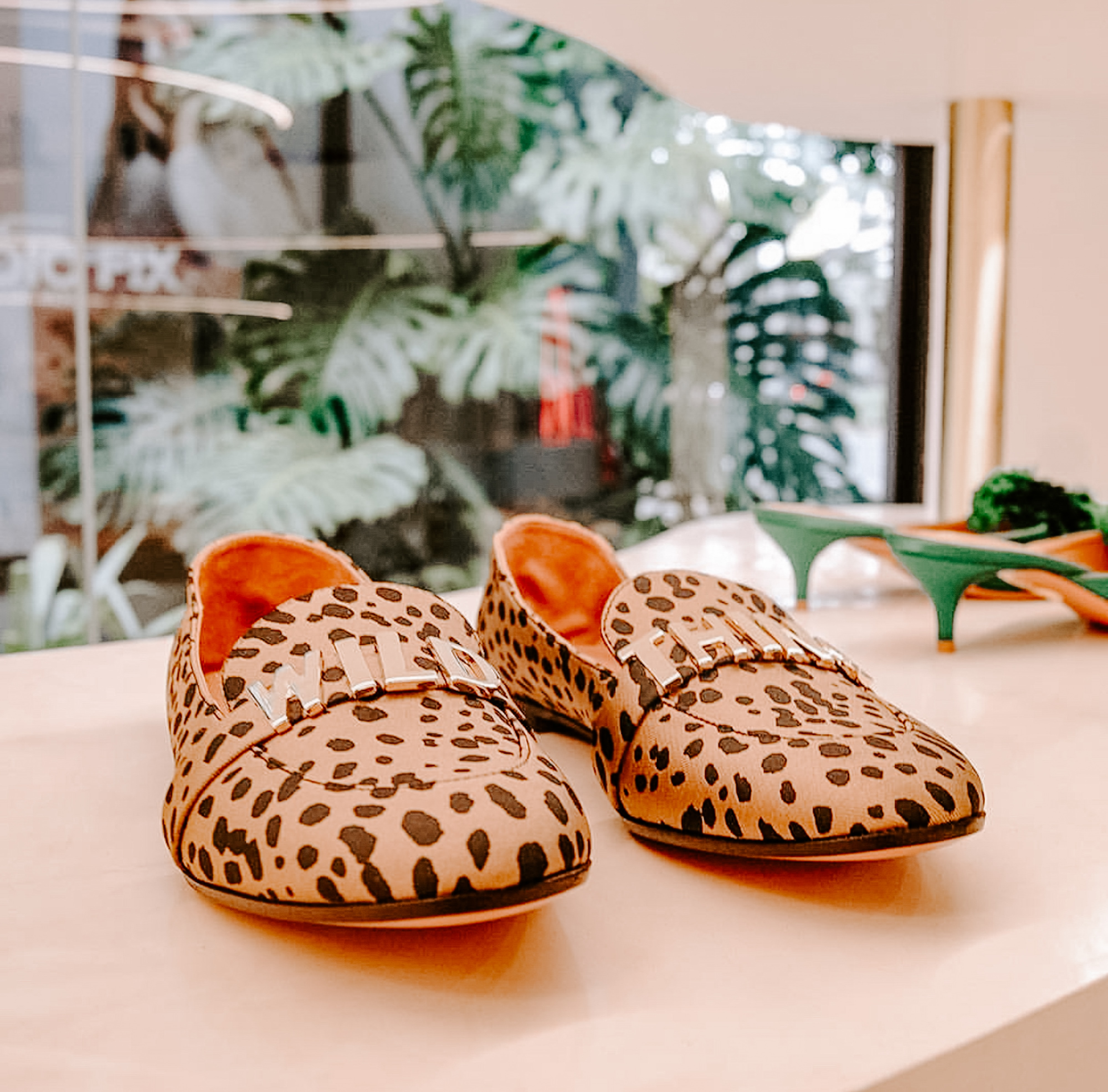 Leopard loafers on display in a store