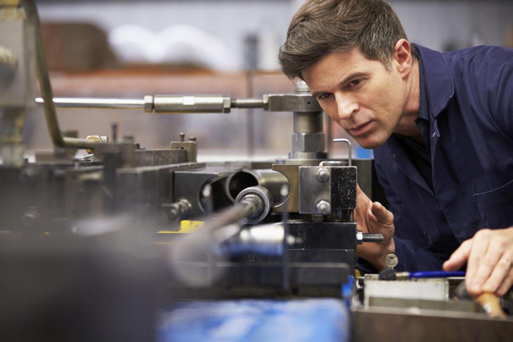 factory engineer operating product development machinery