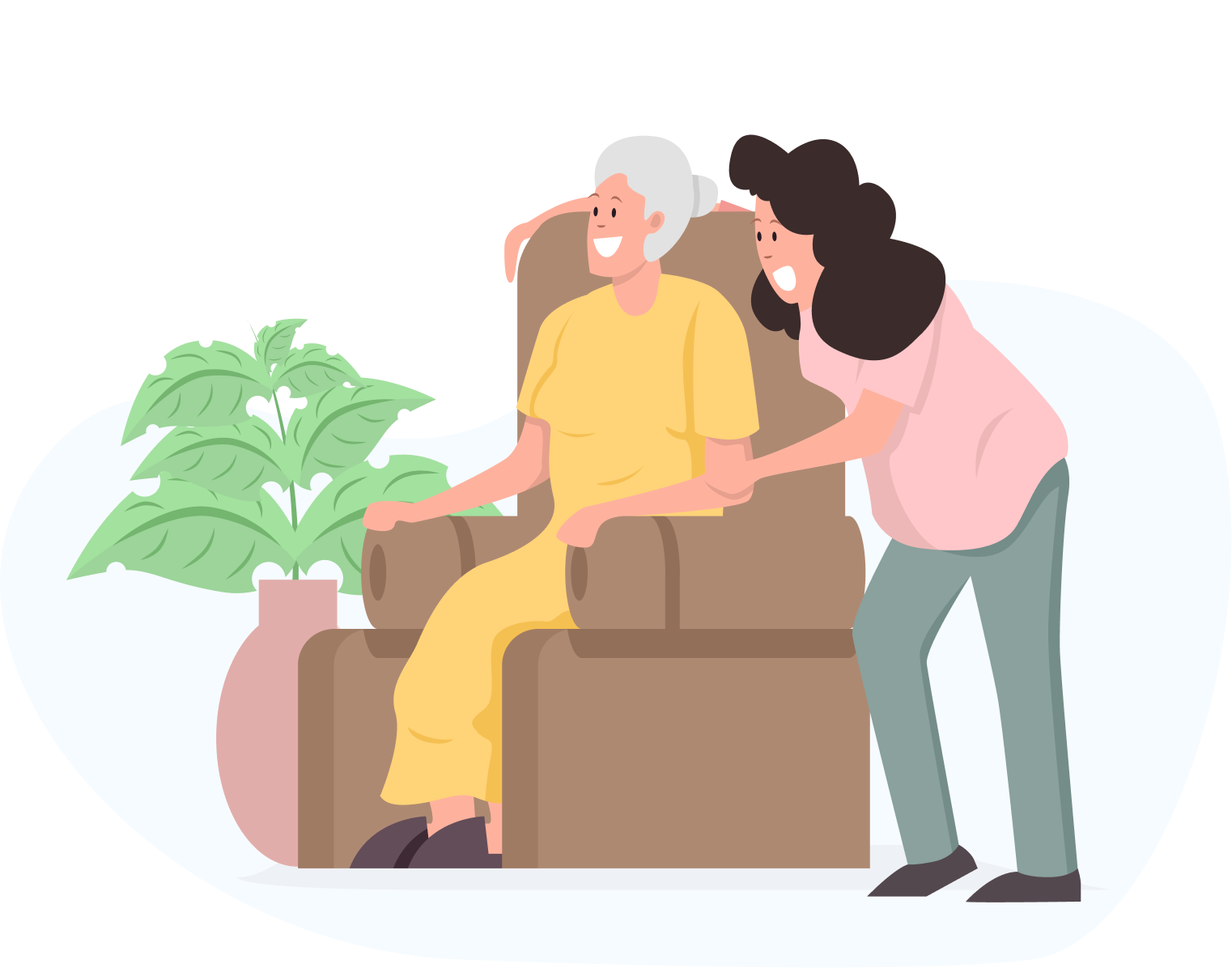 An elderly woman sat in an armchair smiling, with a young woman leaning over her also smiling