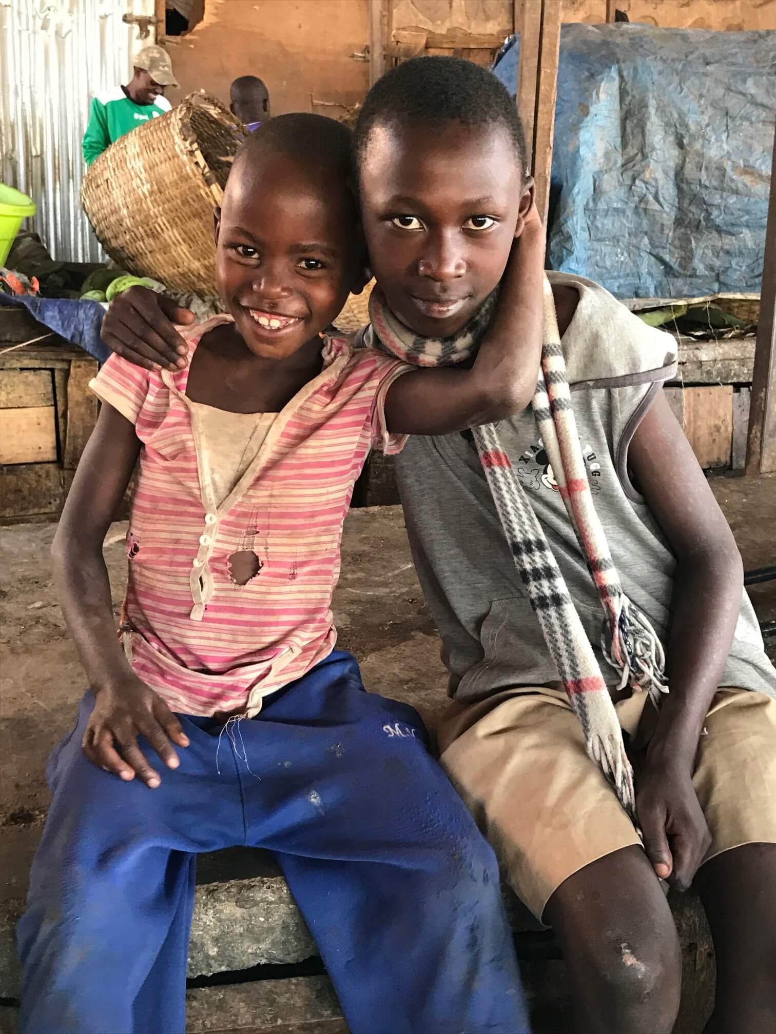 Two smiling Rwandan kids