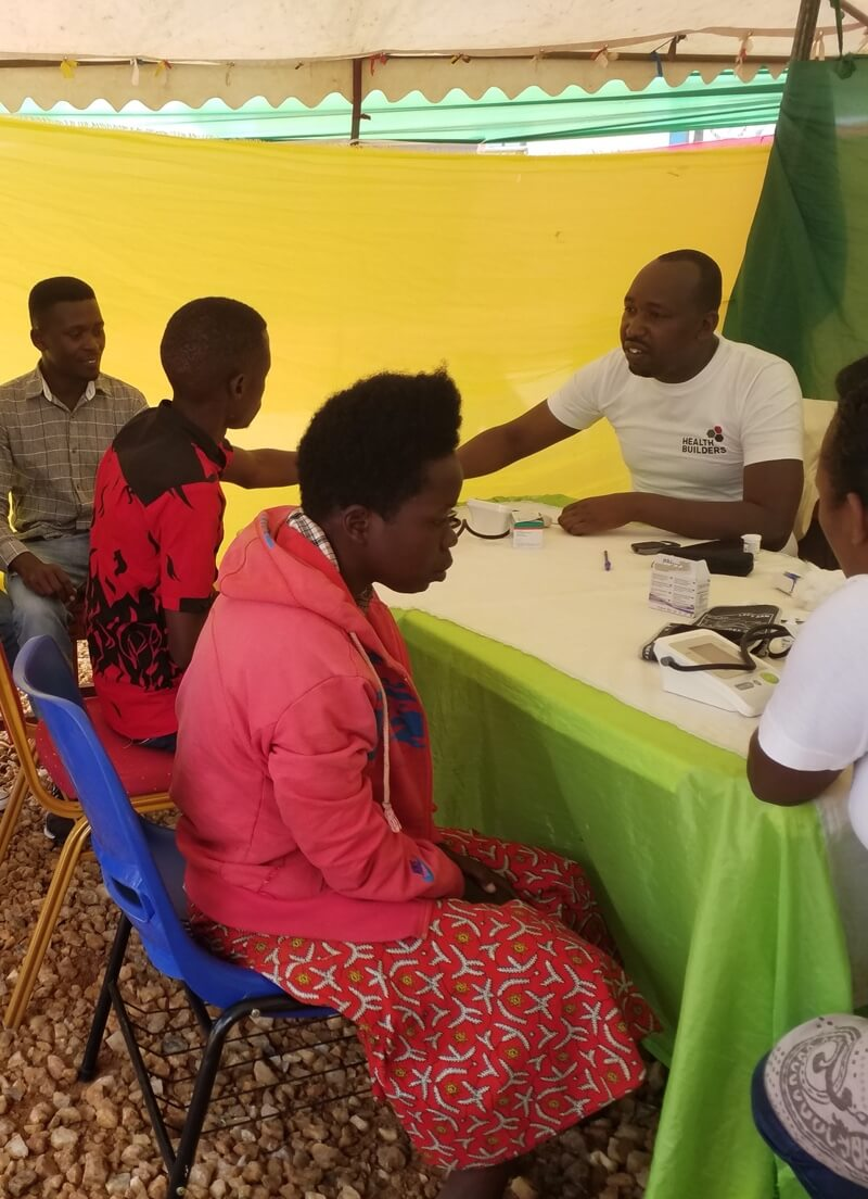 Health Builders leadership team in front of main office