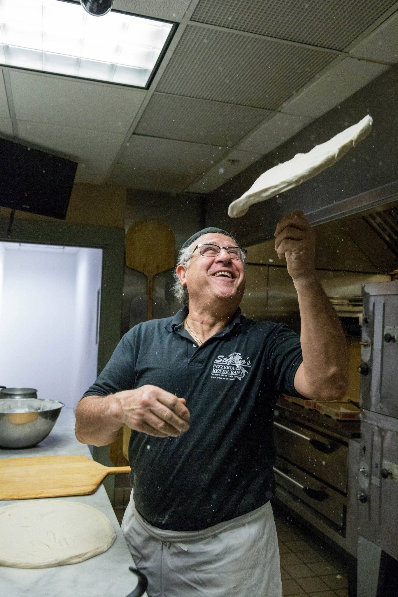 Owner Tossing Dough