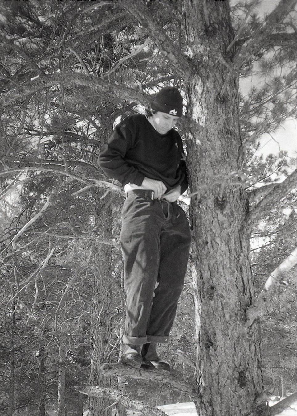 Matt pullin up pants in tree