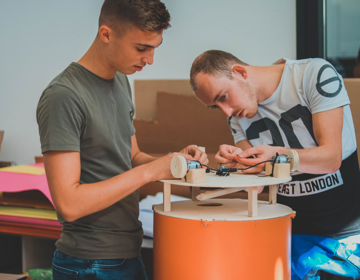 Two Fontys Pulsed students concentrating hard while building their prototype