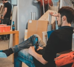 A student chilling in the Fontys Pulsed living room