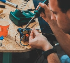 Fontys Pulsed student soldering hardware for his prototype