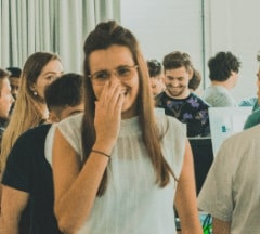 Fontys Pulsed student laughing while covering her mouth
