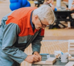 An older man is creating a prototype during a Fontys Pulsed event