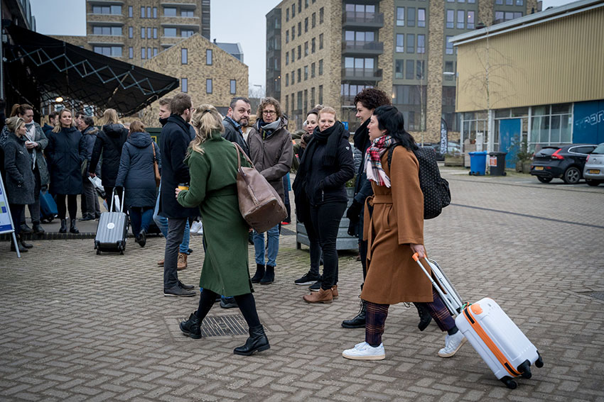 People with suitcases gathering in front of Fifth NRE to start their multi-day Educational Design Expedition.