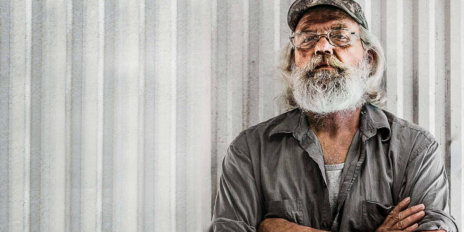 American, white-bearded, weathered man who works hard at the Ferche mill