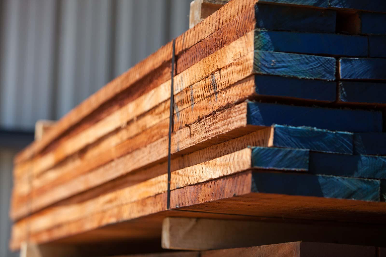 Strong, heavy pile of Ferche raw lumber