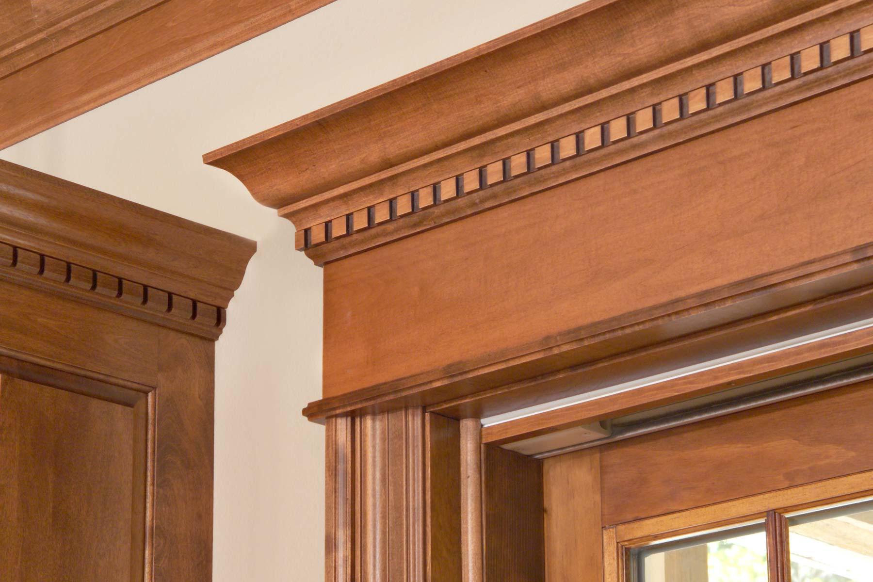 Fine hardwood door topper with a regal tone