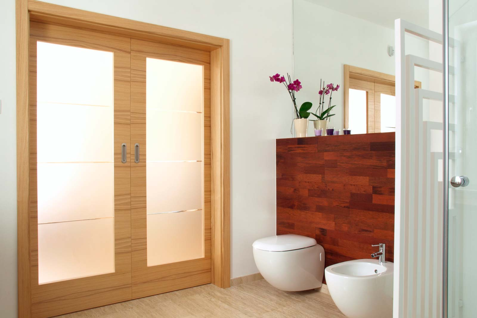 modern bathroom with beautiful, brightly framed doors