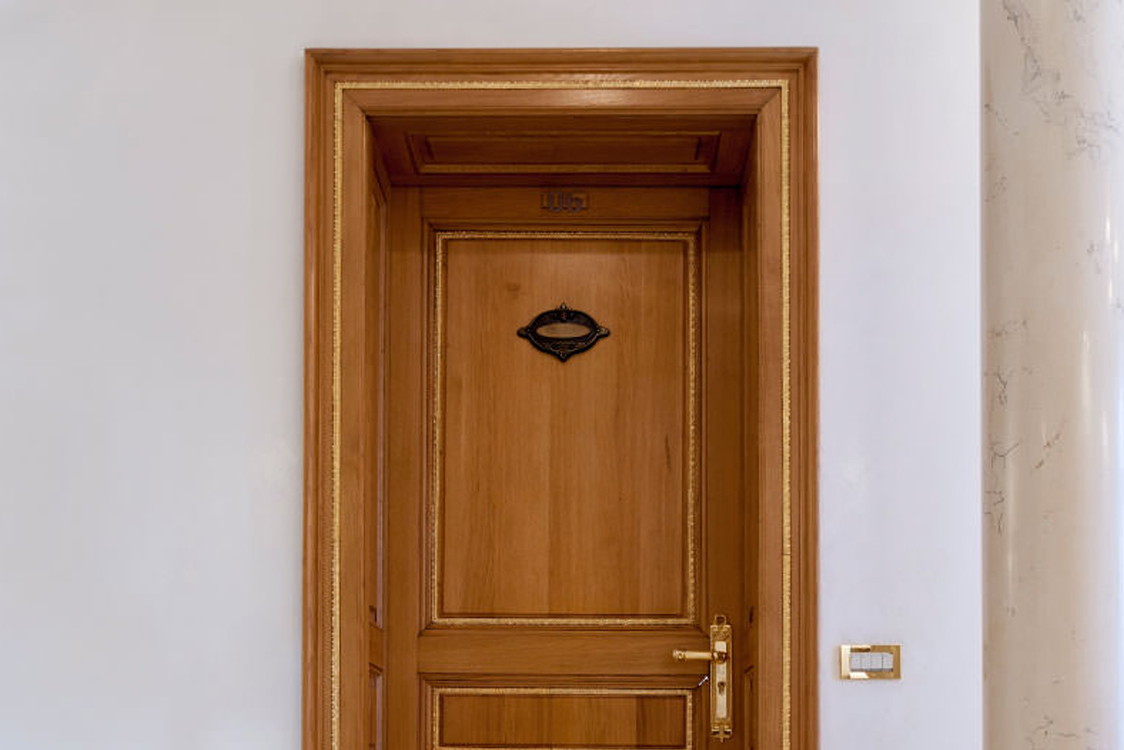 Wood fire-rated door frame in historic building