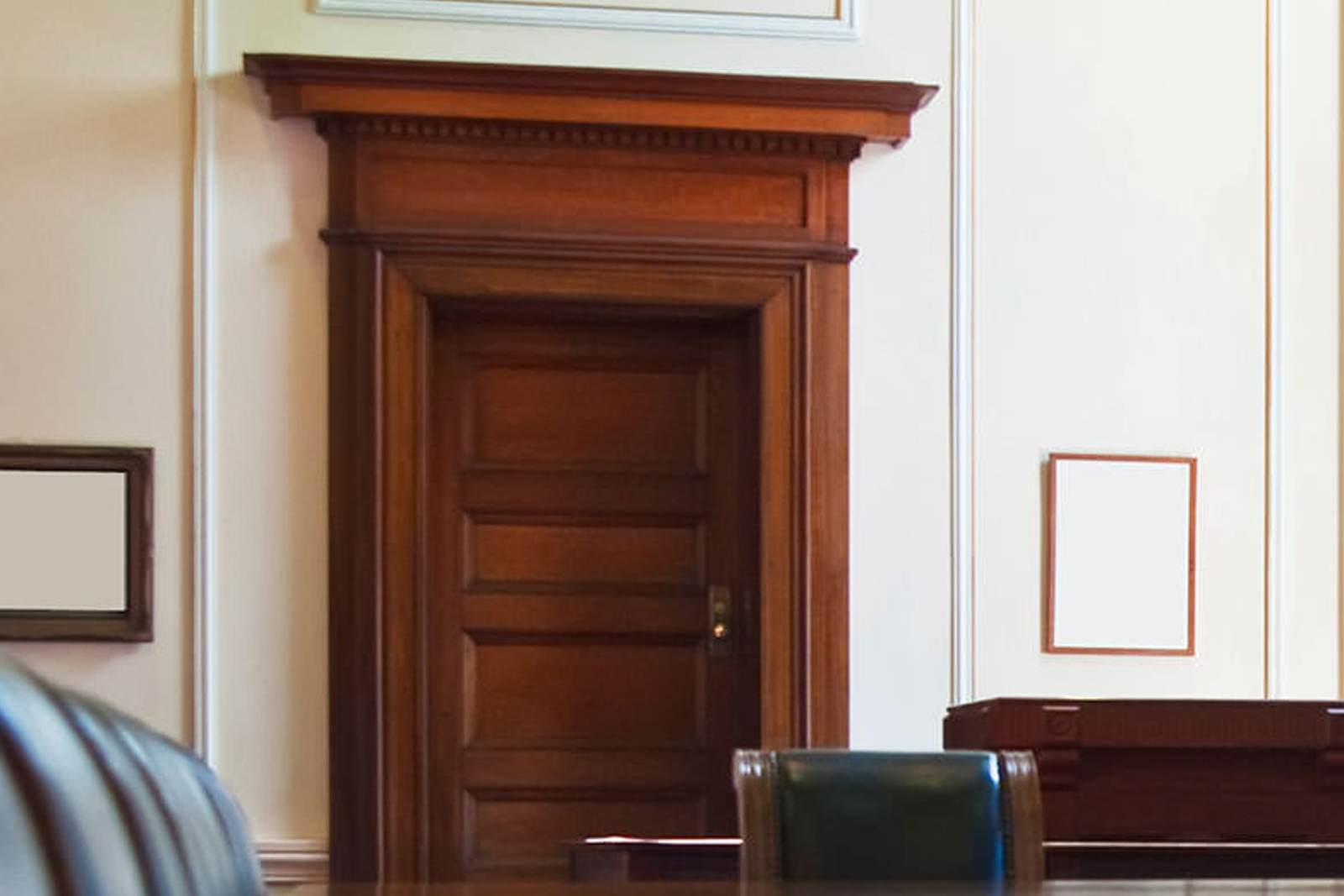 Wood fire-rated door frame in office conference room