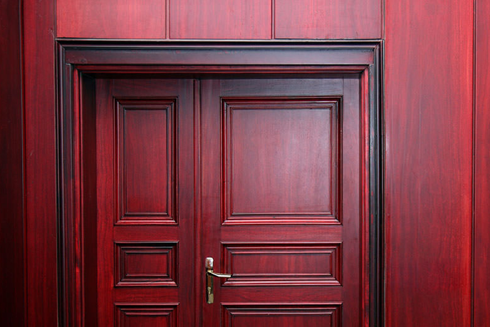 Red wood fire-rated door frame