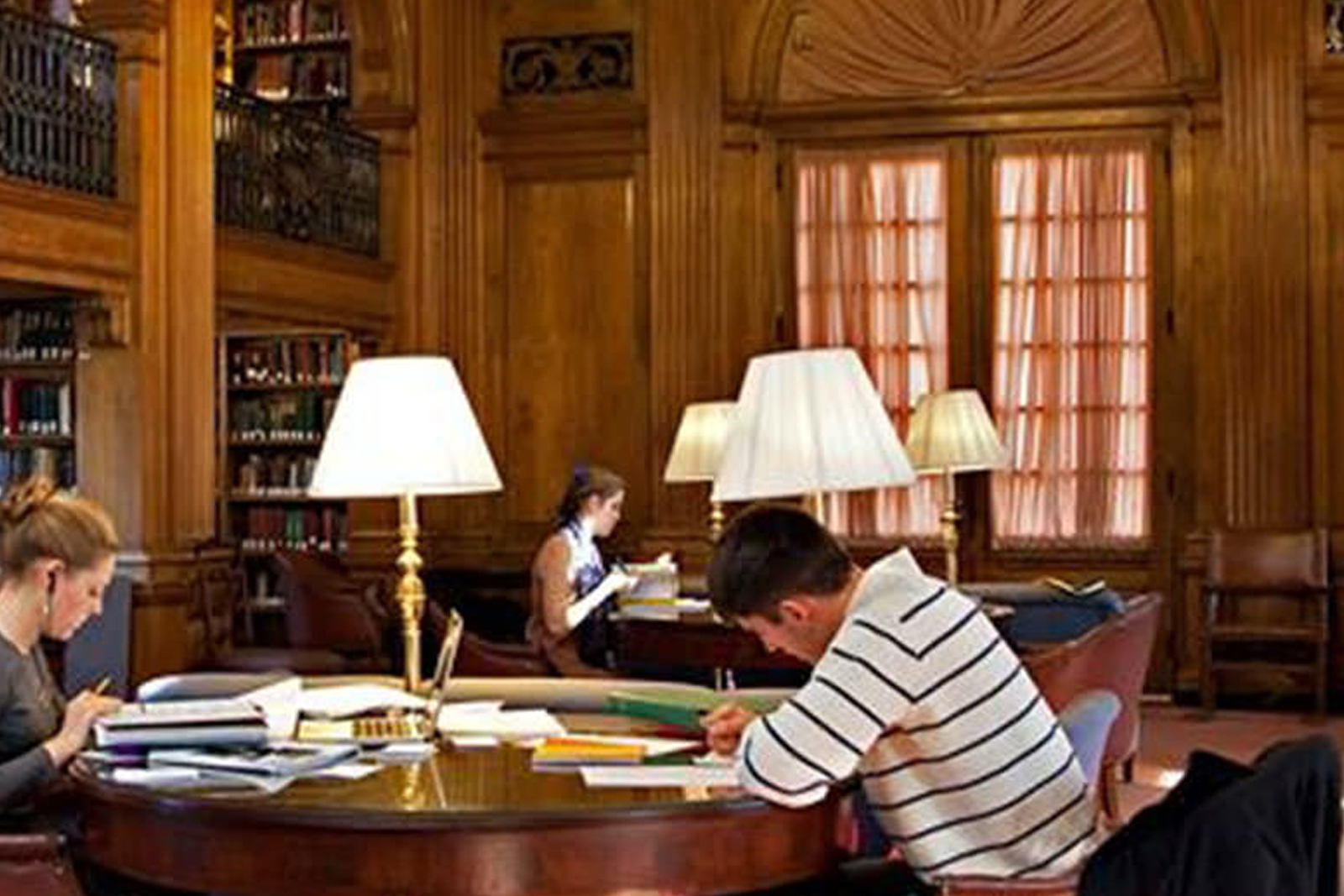 Students studying in a library surrounded by wood fire-rated door frames