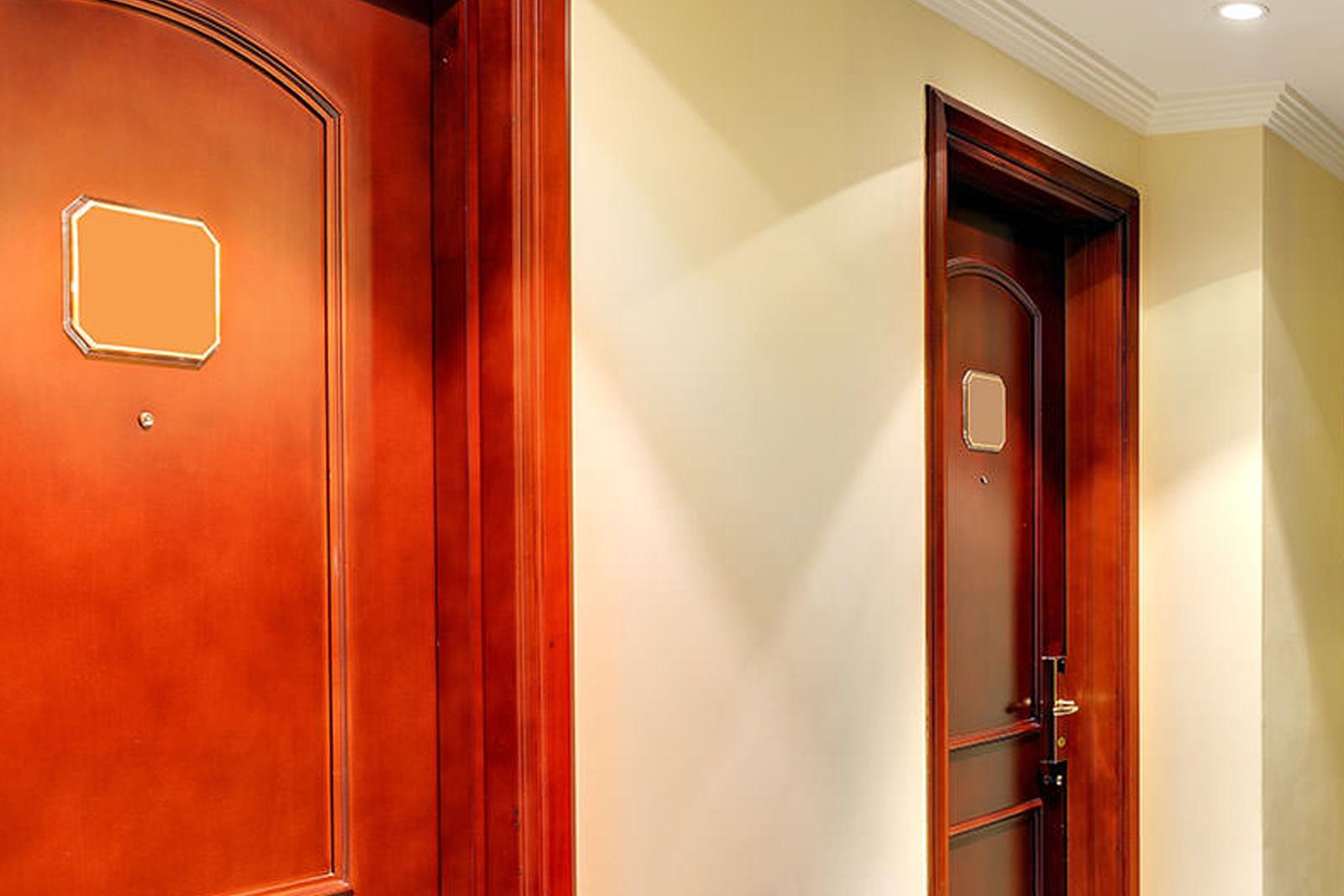 Wood fire-rated door frames in a hallway