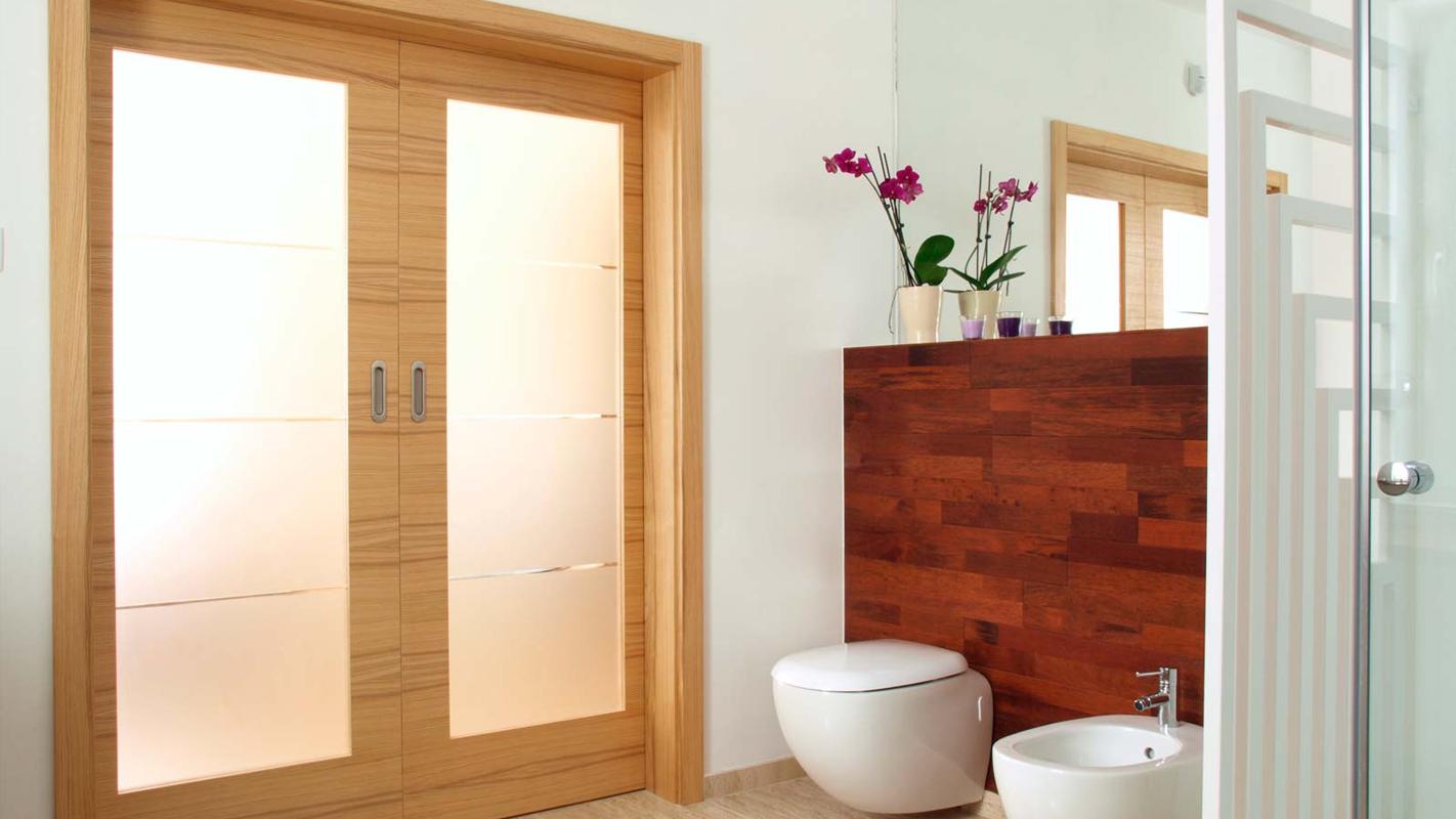 Wood fire-rated door frame in bathroom