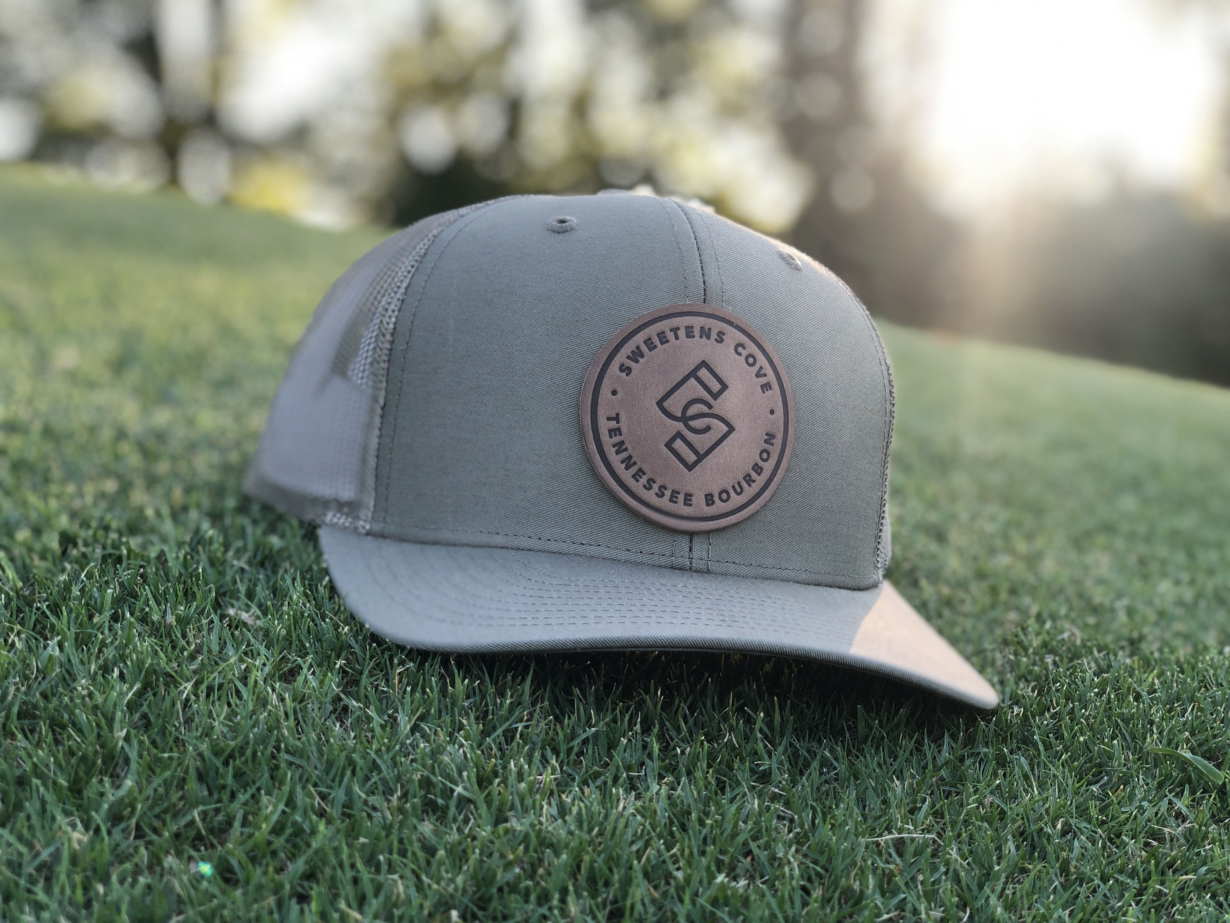 Leather Stamp Trucker Hat in Moss