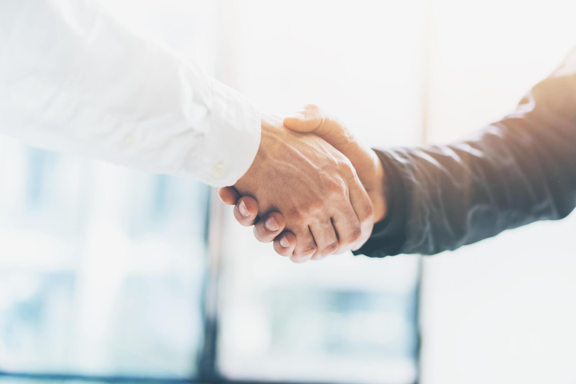 Cambridge Immigration, Work Visa, Skilled Worker, Employer, Shake hands