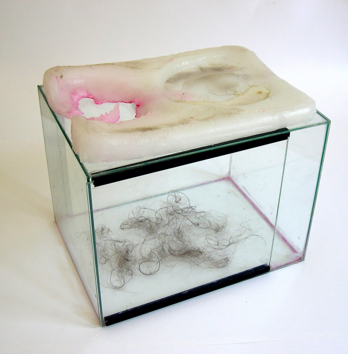 "Claudia Barthoi ""115 Maujer [Alicia's Keys]"",2007, Installation, glass case, urine enclosed in wax, human hair, conditioner, dust, vaseline, lippgloss, pigment, original apartmentkeys, tape, 40 x 30 x 36 cm [16""x12""x14""]"