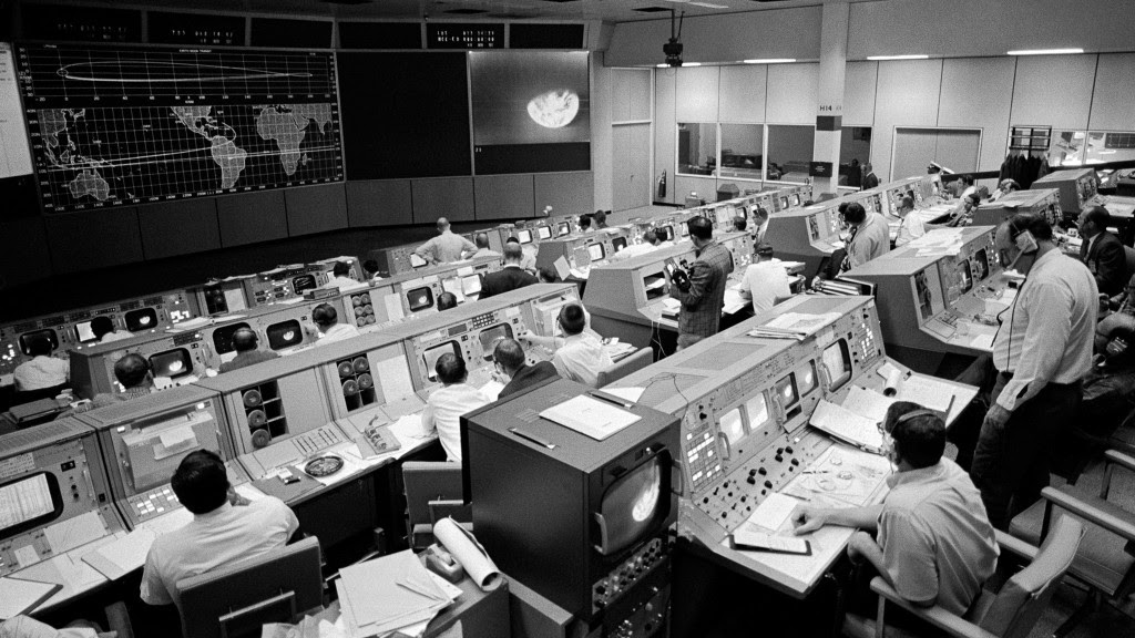 Black and white photo of Mission Control with flight controllers working.