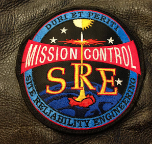 "Google SRE's patch which says ""Mission Control SRE"" and looks nearly identical to the NASA Mission Control patch."