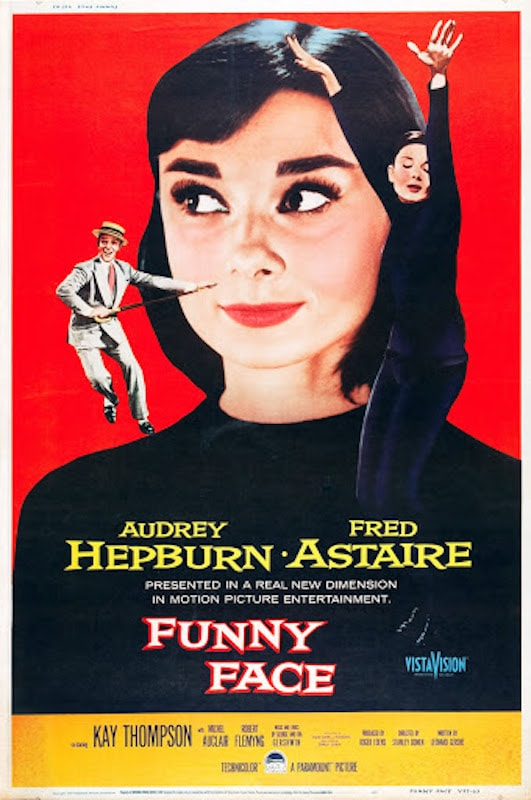 Poster of the movie Funny Face with a large portrait of Audrey Hepburn wearing a Beatnik outfit on a red background, with two small characters dancing on her shoulders.