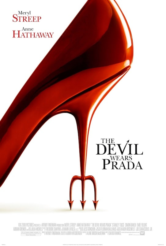 Poster of the movie The Devil Wears Prada with a close-up photo of a shining high-heel red shoe with a Devil's fork making up the heel.