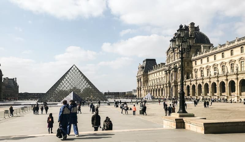 Day view of the Louvre Pyramid in the center of the Napoleon Courtyard of the Louvre Palace