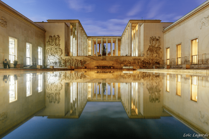 Night view of the Palace with a perfect reflection of the building in the basin