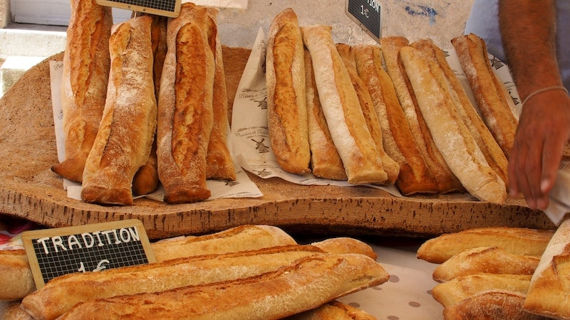 Crispy baguettes at a bakery on display.