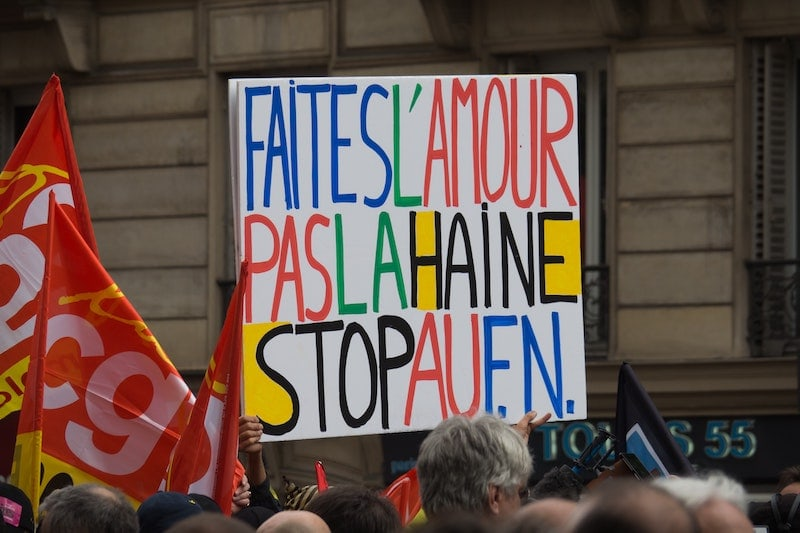 Slogan waved during a strike against the far-right wing political group: 'Make love, not hate, stop the FN'.