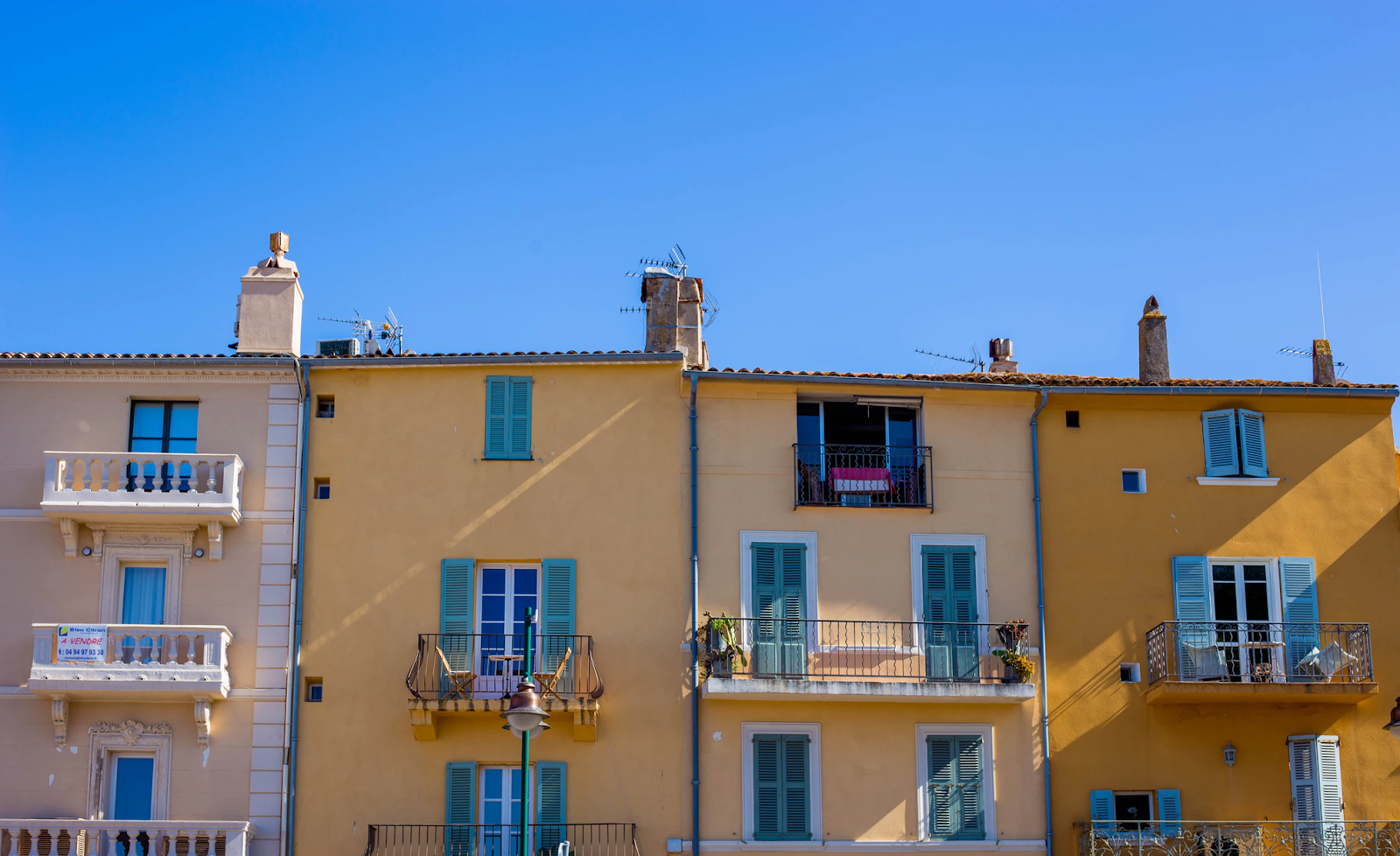 View of four colourful houses in Saint Tropez