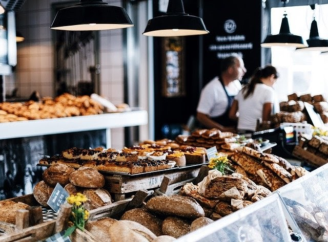 A counter of a boulangerie filled with all sorts of bread
