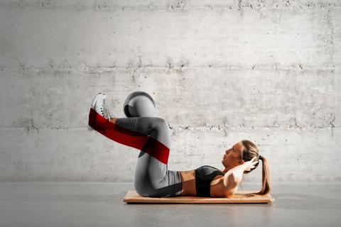 Woman doing a body hold exercise on the floor